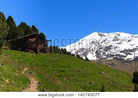 Old Wooden Hut, Hiking Path And Mountain Palon De La Mare Panorama In Ortler Alps, Italy