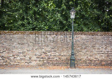 Lamp post street on brick wall background