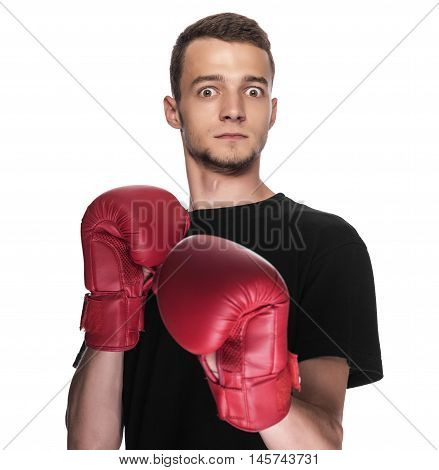 Cowardly funny young man in red boxing gloves.