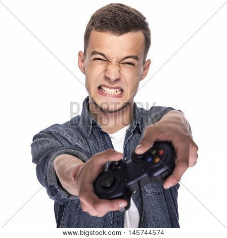 Young man playing on console or computer using a gamepad.