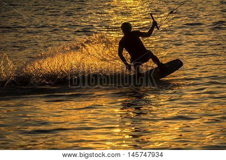 The Silhouette Wakeboarder in action on sunset