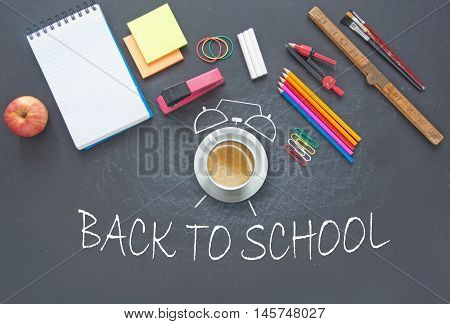Back to school background with education stationery and tools as well as clock symbol around a coffee cup