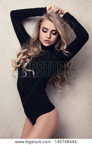 Blonde Sexy Girl With Long Hair And Glamour Makeup.