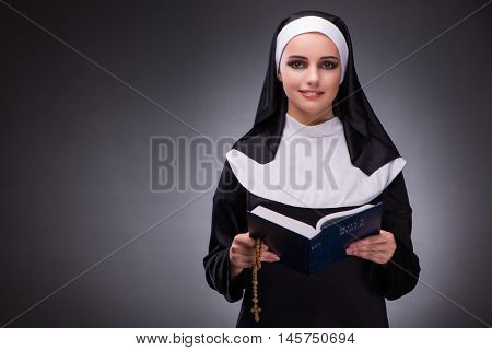 Religious nun in religion concept against dark background