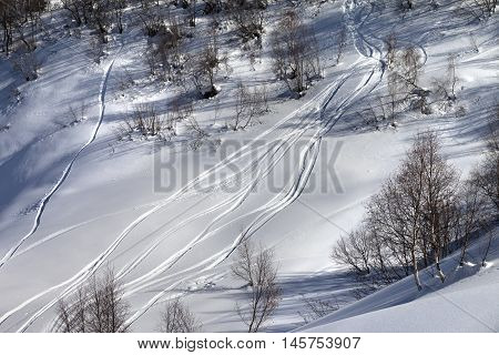 Off-piste Slope With Track From Ski And Snowboard In Sunny Day