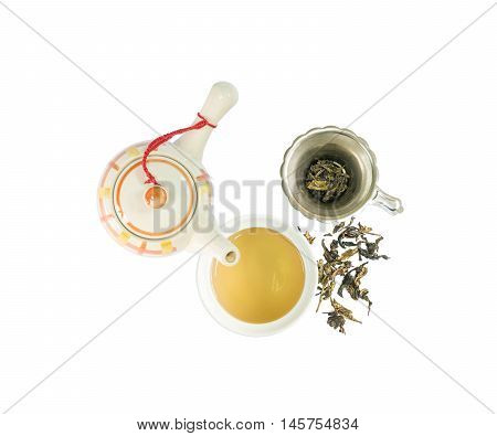 Closeup beautiful ceramic tea pot and cup of tea with dried tea leave isolated on with background in top view