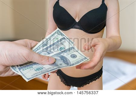 Prostitution Concept. Young Sexy Hooker Is Taking Money For Her