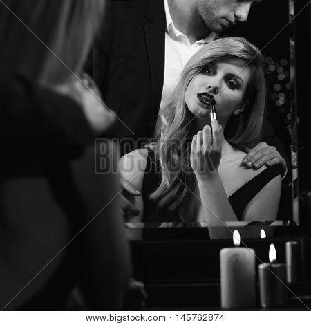Seductive Woman Putting On Lipstick