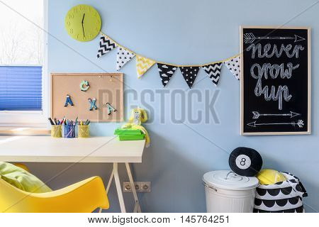 Learning area in a child room with places to put notes and write down ideas