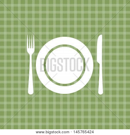 Plate knife and fork on green picnic checkered tablecloth