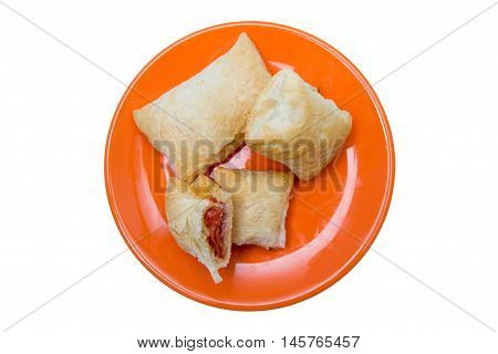 Puff pastry appetizers with salami and cheese on a white background seen from above