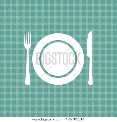Plate knife and fork on turquoise picnic checkered tablecloth