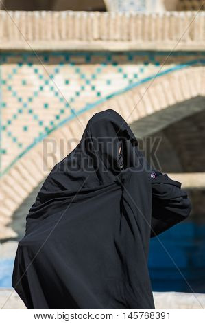 Muslim Woman With Traditional Chador On The Street