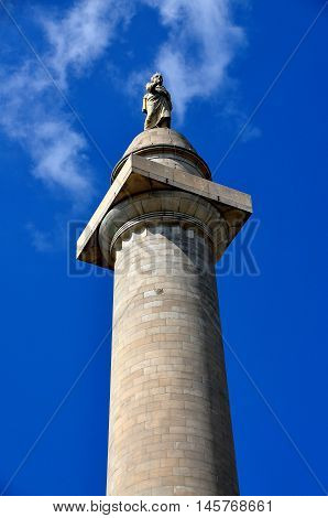 Baltimore Maryland - July 23 2013: Statue of George Washington dressed in a Roman toga tops the memorial column named in his honour at the center of Mount Vernon Place