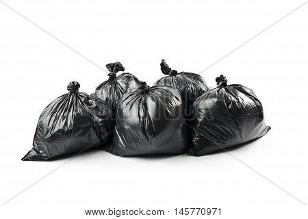 Black garbage bags isolated on white background