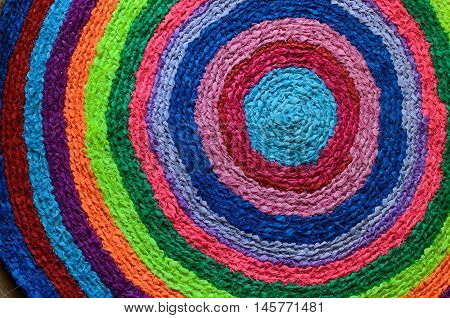 Colorful round handmade floor carpet mat made of ribbons and rags