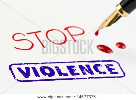 Stop violence stamped on white paper. Red ink drops from fountain pen.