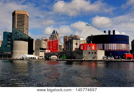 Baltimore Maryland - July 22 2013: The futuristic National Aquarium with its glass triangular roofs built over the waters at Inner Harbor
