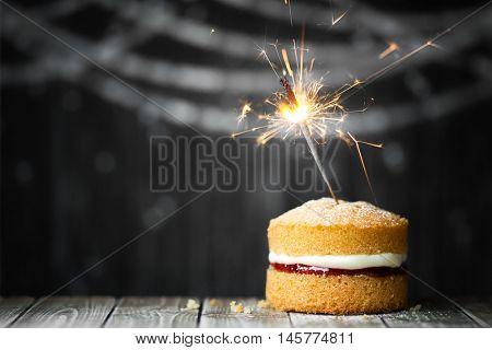 Mini cake with celebration sparkler
