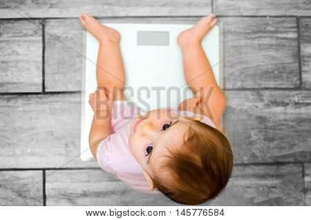 baby weight scale newborn grey floor background