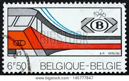 BELGIUM - CIRCA 1976: a stamp printed in the Belgium shows Electric Train and Society Emblem 50th Anniversary of the National Belgian Railroad Society circa 1976