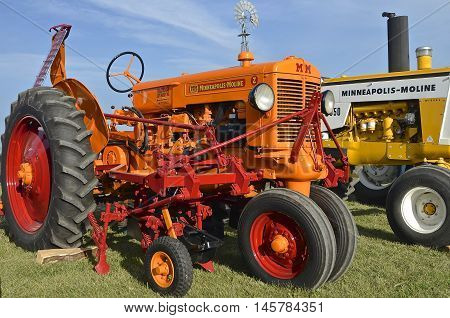 ROLLAG, MINNESOTA, Sept 1, 2016: An Minneapolis Moline Z tractor with a field cultivator is parked at the West Central Steam Threshers Reunion(WCSTR) where 1000s attend each Labor Day weekend in Rollag, MN each year.
