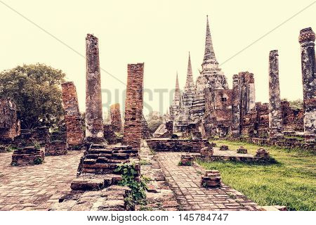 Vintage style ruins and pagoda ancient architecture of Wat Phra Si Sanphet old temple famous attractions during sunset at Phra Nakhon Si Ayutthaya Historical Park in Ayutthaya Province Thailand