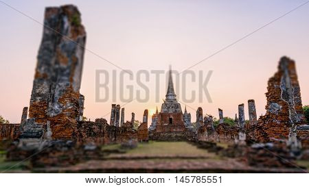 Tilt-Shift for background Ancient ruins and pagoda of Wat Phra Si Sanphet old temple famous attractions during sunset at Phra Nakhon Si Ayutthaya Historical Park Thailand 16:9 wide screen