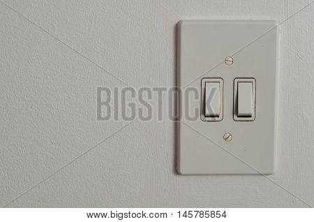 An Electrical light switch displayed on a wall