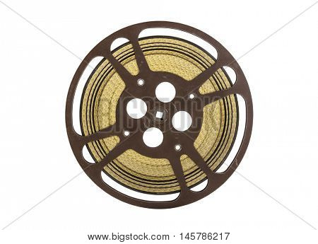 Vintage 16 mm movie film reel isolated on white.