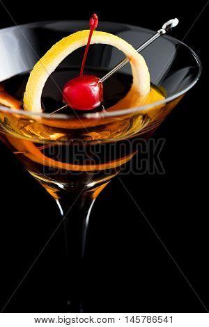 Manhattan Cocktails On Black Background With Garnish