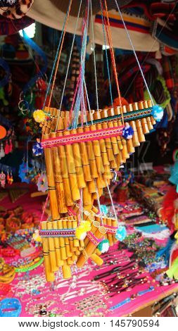 Banos de Agua Santa, Tungurahua / Ecuador - September 2 2016: Indian handmade panpipe sale at a craft store in the Pasaje Artesanal in the downtown of the city of Banos