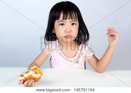 Asian Chinese Little Girl Refusing Eating Burger