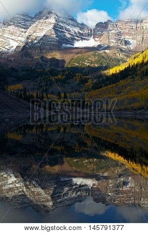 Maroon Bells reflecting in Maroon Lake near Aspen Colorado