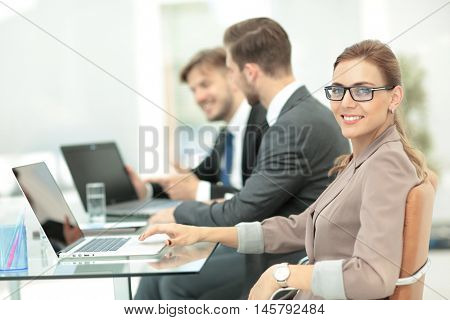 Beautiful modern businesswoman  working with  her colleagues on
