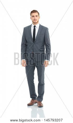 Happy business man wearing grey suit standing and folding arms