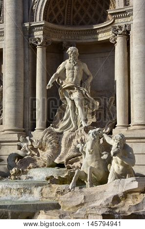 Oceanus god and triton taming a sea horse from the wonderful baroque Trevi Fountain in the center of Rome