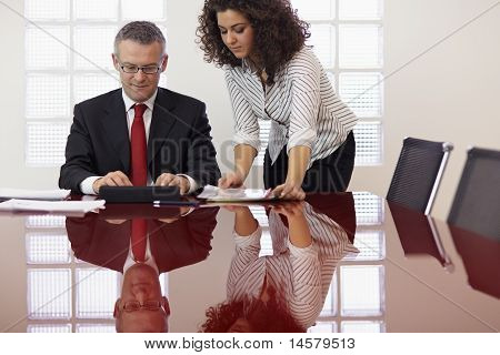 Businessman And Assistant With Tablet Pc