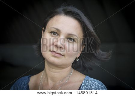 Portrait of an adult woman melancholic  on black background