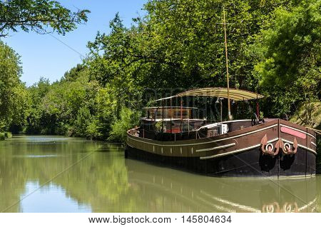 A beautiful barge on midi canal near Carcassonne in France