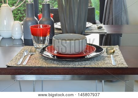 Close up modern dining set on wooden dining table
