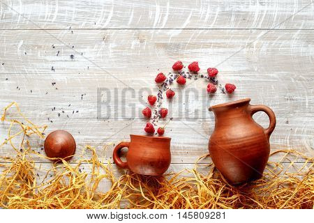 still life pottery - country life with berries on wooden background