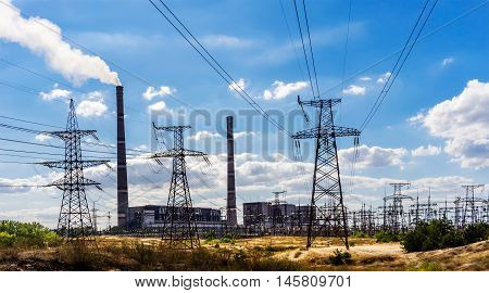 coal-fired power plant and transmission lines in the foreground