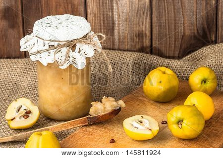 Quince preserves in a wooden pantry. Fruit jam in jar.