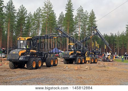 JAMSA FINLAND - SEPTEMBER 2 2016: Two unnamed professionals compete on Ponsse forwarders in the National Forest Machine Operator Competition held on the heavy machinery exhibition FinnMETKO 2016.
