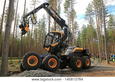 JAMSA FINLAND - SEPTEMBER 2 2016: Ponsse presents harvester Scorpion King in a work demonstration on the heavy machinery exhibition FinnMETKO 2016 in Jamsa Finland.
