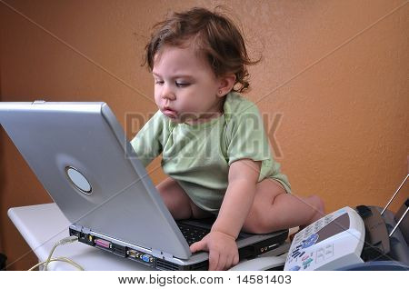 Baby hard at work on her laptop