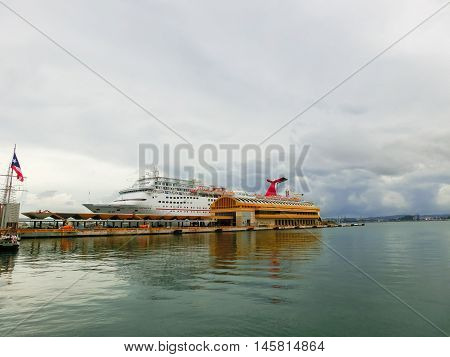 San Juan, Puerto Rico - May 08, 2016: The Carnival Cruise Ship Fascination, at dock. She is one of 8 sister ships and received a million dollar refurbishment in 2006