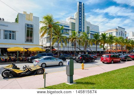 MIAMI BEACH, USA - AUGUST 27, 2016 : Colorful summer day at Ocean Drive, a popular tourist destination and home of several famous hotels, restaurants and discos in South Beach