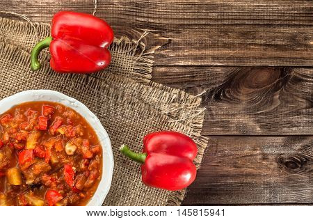 Hungarian stew or lecho with paprika and meat, cooking concept.